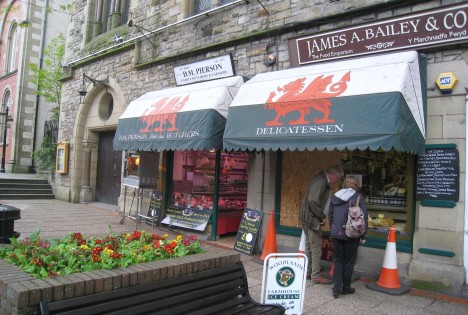 Y Ddraig Goch on shop awnings, Llangollen, Wales