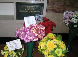Marj's casket with flowers from Jack