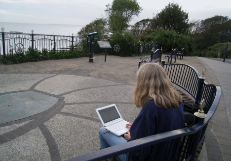 Checking e-mail at the top of Wolsey Gardens, Felixstowe