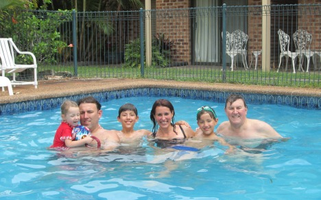 Clive with his son & amily in the pool, January 2014