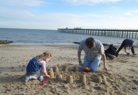 Clive & his grandchildren, busy on the beach, Felixstowe