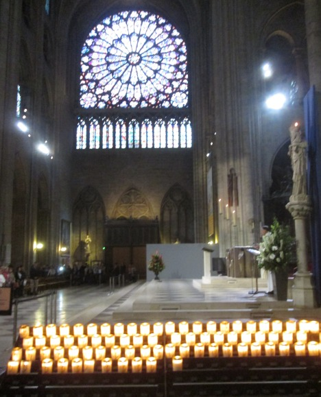 Candles burning at Notre Dame de Paris, two in particular for my stepson and his donor