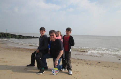 Clive with his grandchildren in Felixstowe last September