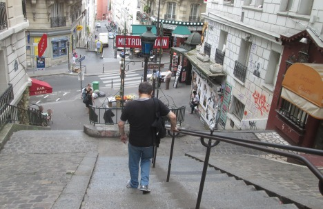 Clive heading down the Butte Montmartre toward the metro