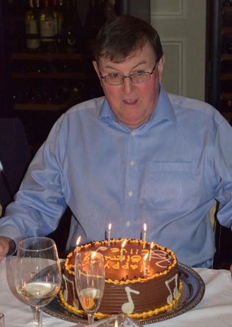 Music-loving Clive ready to blow out the candles on his birthday cake