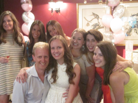 The groom with his bride and her bridesmaids